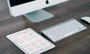 Image of electronic calendar next to desktop computer
